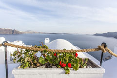 View at the volcano and the sea at Santorini island with a church in the front. - The Cyclades - Greece Royalty Free Stock Photography