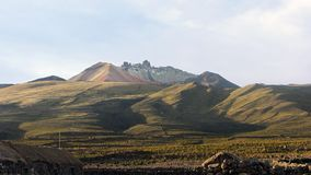 View of the volcano Tunupa from the town of Chatahuana. stock photo