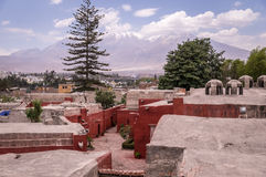 View on volcanoes from Santa Catalina monastery in Arequipa, Peru. View over Novice Cloister of Santa Catalina monastery on Misti volcano in Arequipa, Peru Royalty Free Stock Photo