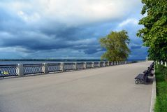 View on the Volga embankment of the Samara city in anticipation of thunderstorm. View on the Volga quay of the Samara city in anticipation of thunderstorm. City Stock Images