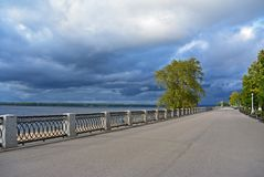 View on the Volga embankment of the Samara city in anticipation of thunderstorm. View on the Volga quay of the Samara city in anticipation of thunderstorm. City Stock Photography
