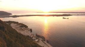View on the Volga river with the mountains. Sunset on the Volga river, shooting from the air stock footage
