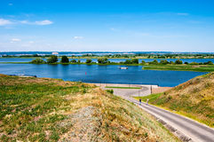View of the Volga-river, during a sunny day. This photo shows the view of Kuybushevskoye storage reservoir - the part of Volga-river. The narrow road lead to the Stock Images