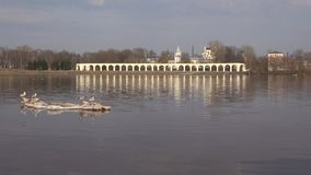 View of the Volkhov river and Yaroslav court. Veliky Novgorod, Russia. View of the Volkhov river and Yaroslav court on April day. Veliky Novgorod, Russia stock footage