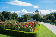 A view of Volksgarten park at Vienna. A view of Volksgarten park with flowering red roses in front of Hofburg, Vienna, Austria Stock Images