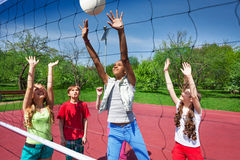 View through volleyball net of playing children Royalty Free Stock Photos