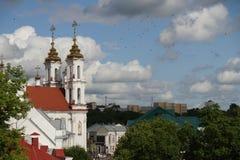 View of Voskresenskaya (Rynkovaya) church, Vitebsk, Belarus. On a bright sunny day with multiple birds flying around in the sky Royalty Free Stock Photo