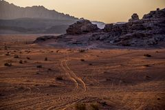 View of the Wadi-Rum desert in Jordanié, with its erratic high mountains and the red-golden sand at sunset. stock photography
