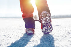 View of walking on snow with Snow shoes and Shoe spikes in winter. Vintage tone Stock Image