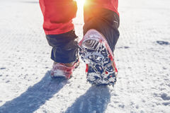 View of walking on snow with Snow shoes and Shoe spikes in winter. Vintage tone Royalty Free Stock Image