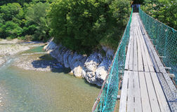 View of walking suspension bridge and mountain river of left Royalty Free Stock Image