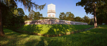 View of the wall of the Bastion and the White Tower in the Alexander Park in Tsarskoye Selo. Pavilion White Tower behind the wall of a bastion in the Alexander Stock Photo