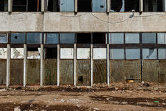 View of a wall with the broken windows and lattices. Front. Royalty Free Stock Images