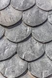 View of wall lined with slate-shaped fish scales, from a ruined building. Detailed view of wall texture lined with slate-shaped fish scales, from a ruined stock photography