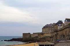 View from the wall of the old city with granite buildings of Saint-Malo in Brittany, France. Saint Malo beach, sea and beach stock photos