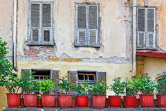 View of a wall of an old house with wooden shutters Stock Photography