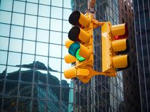 View on wall street yellow traffic light with black and white pointer guide. Green traffic light to Wall street banks money dollar stock photos