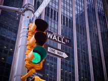 View on Wall street yellow traffic light with black and white Wa stock images