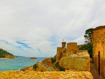 View through walls of ancient fortress in Tossa de mar. Costa Brava, Spain Stock Photo