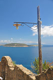 The view from the walls of the Aragonese castle on the island an. D the blue sea, and the lantern on blue sky background Stock Photo