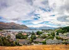 View from above of Wanaka alpine resort town in New Zealand. View of Wanaka lake and alpine resort town with the mountain range in the background from the Wanaka Royalty Free Stock Photography