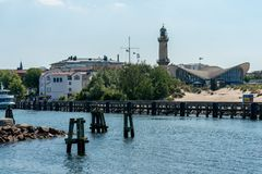 View on Warnemuende lighthouse and Teepott from a ship royalty free stock photography