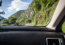 View on warning of landslide sign on road from inside of car Stock Photos
