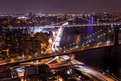 View was made from The Top of Manhattan's roof Manhattan New York City. The beautiful view on the Brooklyn & Manhattan Bridges was made from the top of Manhattan stock photo