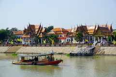 View of Wat Kasutlatirat-Vorlawiharn temple and one boat Stock Images