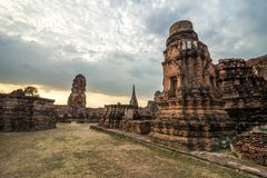 Wat Mahathat temple in cloudy day in Ayutthaya, Thailand. View of Wat Mahathat temple in cloudy day in Ayutthaya, Thailand Stock Photo