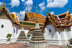 A view of Wat Pho with Phra Ubosot. Nice roofs and deep blue sky in Wat Pho temple in Bangkok Stock Images