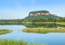 View of wat Phuthok or wat Jatiyakeeree viharn on cliff high mountain reflection on the water in lake at Bueng Kan. View of wat Phuthok or wat Jatiyakeeree stock photos