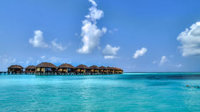 View of water bungalows in tropical paradise. During a hot spring day Stock Image