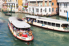 View of water buses in Grand Canal in Venice. VENICE, ITALY - MARCH 30, 2017: view of water buses with tourists in Grand Canal in Venice city from Rialto bridge Stock Photo