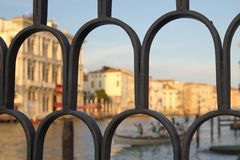 View of water canal through the fence in Venice, Italy Stock Images