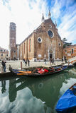 View of water canal in front of Basilica dei Frari Royalty Free Stock Photography
