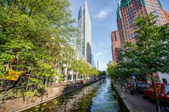 Haag city in Netherland. View on the water channel and beautiful skyscrapers in Haag city, Netherlands Stock Photos