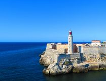 Fort Cabana light house in Havana, Cuba on a clear day. A view from the water of Fort Cabana light house in Havana, Cuba on a clear day royalty free stock image