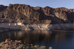 Low water at Lake Mead, Nevada. A view of the water line at Lake mead, behind Hoover dam. Water is supposed to spill over the cement structure on the left Royalty Free Stock Photo