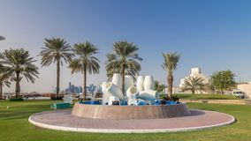 View of the water pots fountain landmark timelapse hyperlapse on the Corniche in Doha. With the distant business towers skyline. Palms is in the background stock footage