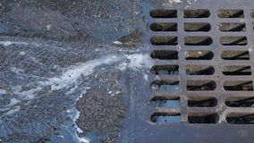 View of Water Runoff Into Storm Sewer on Manhattan Street. Closeup view of water running into a storm sewer on a Manhattan street stock video