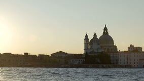 View from water at Salute church dome, famous symbol of Venice, travel to Italy. Stock footage stock footage