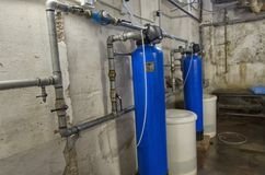 The water softeners in a condominium royalty free stock image