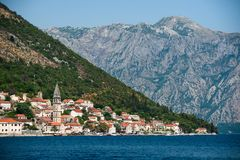 View from the water on the summer city. Of Perast and the mountains Royalty Free Stock Photos