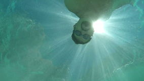 View from the water on the sun`s rays and men stock footage