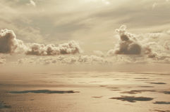 View on water surface, clouds and sea Stock Images
