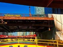 View from water taxi as it crosses the Chicago River underneath construction at the Dearborn Street bridge. stock photos