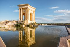 Montpellier city in France. View on the water tower in Peyrou garden with beautiful water reflection during the morning light in Montpellier city in southern royalty free stock photography