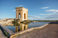 Montpellier city in France. View on the water tower in Peyrou garden with beautiful water reflection during the morning light in Montpellier city in southern stock photo