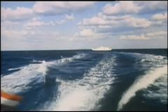 View of water trail from back of boat stock footage